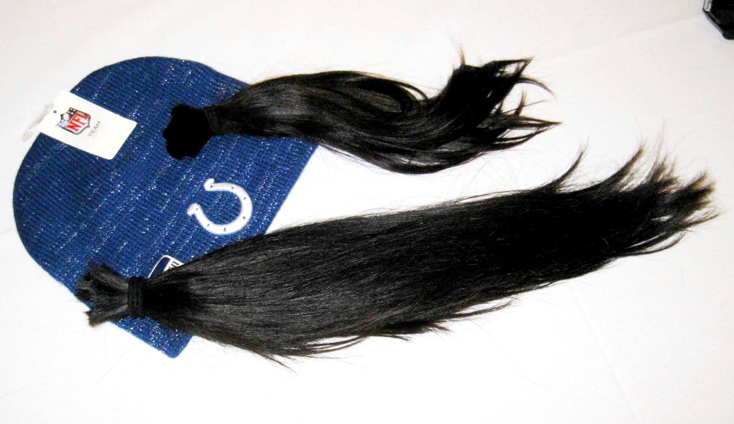 Indianapolis Colts cheerleaders pony tails that were donated to Locks of Love