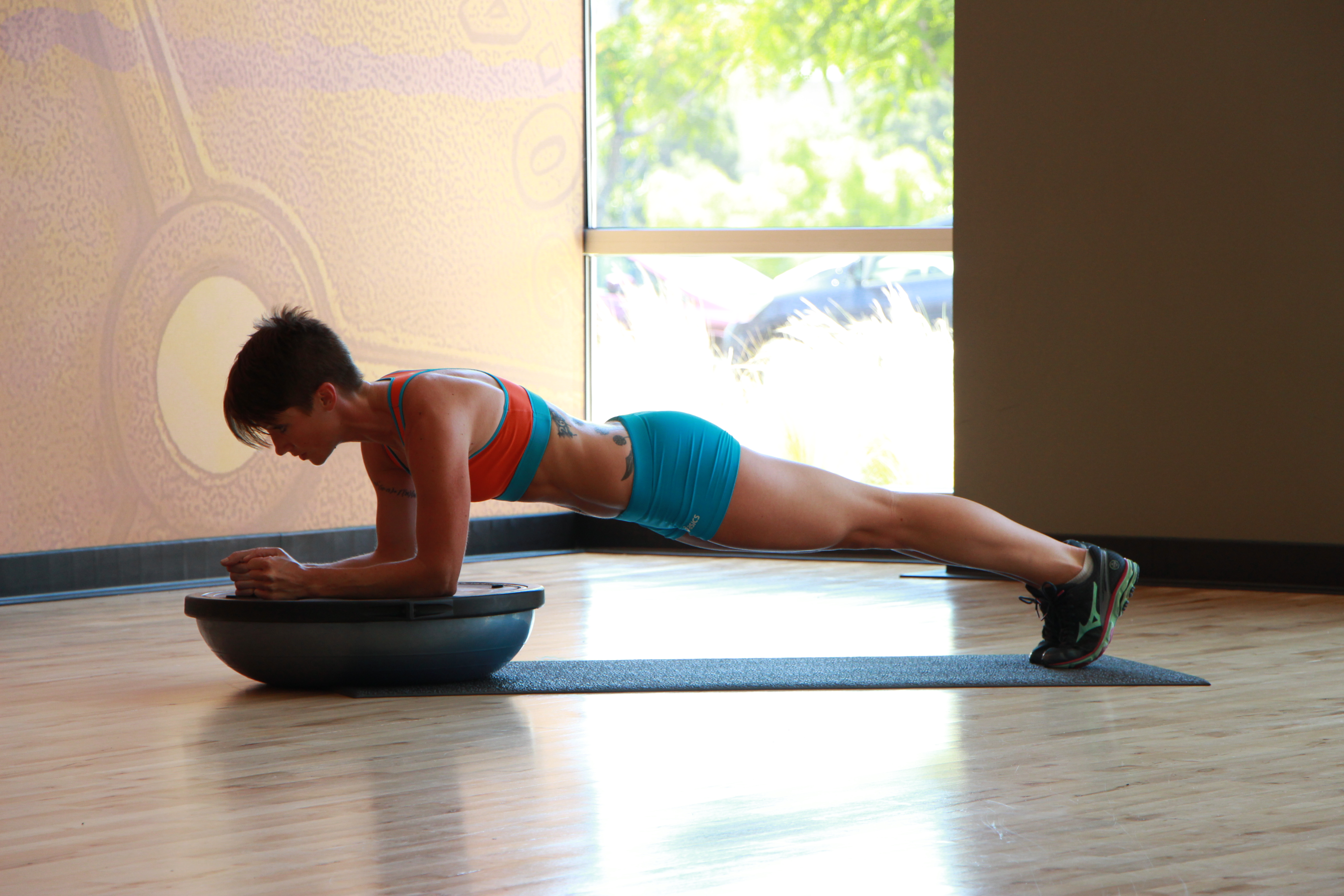 Bethany performing Bosu ball plank - 1