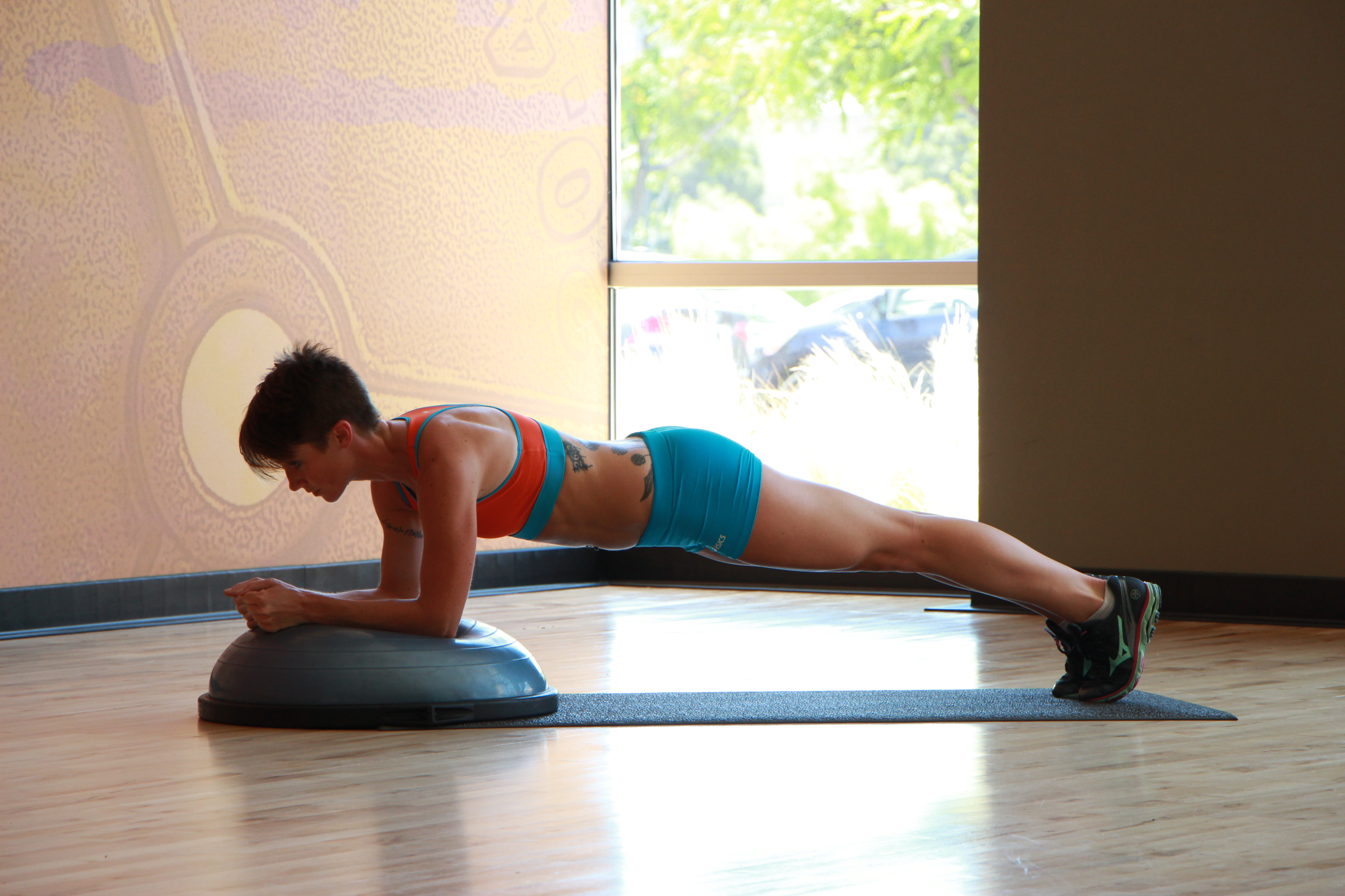 Bethany performing Bosu ball plank - 2