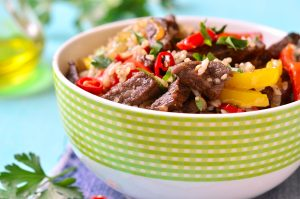 Meat ragout with bell pepper and fried rice.