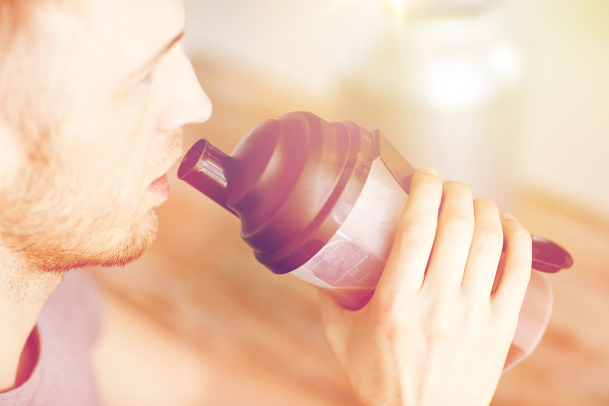 close up of man drinking bcaas
